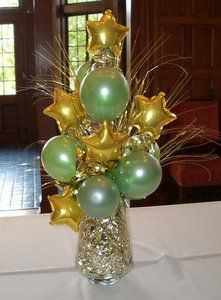 This could be really cute with black and white balloons and silver star balloons...I've got a couple vases that would work really well for that if you like it