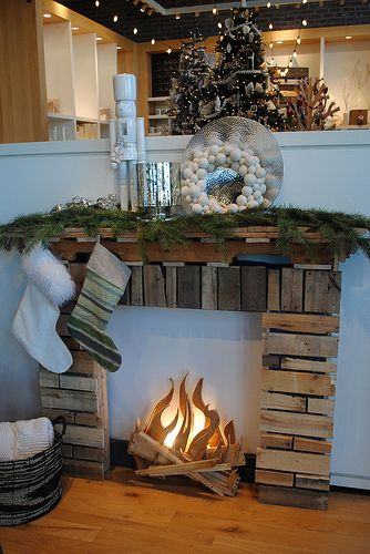 Cool faux fireplace so you can really hang the stockings, and have a mantle to decorate and make pretty. Christmas decorations ideas