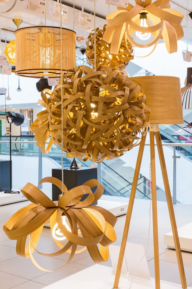 Tom Raffield 'Designer Room' in John Lewis, Oxford St. The brief for our room was to create a space that was a true reflection of the designer, and a room they felt at home in. Our space was an amalgamation of three spaces, the workshop, the woodland showroom and Tom's home. The space showcases wooden lighting and furniture designs hand crafted by Tom Raffield and his team in Cornwall, using traditional steam bending methods.
