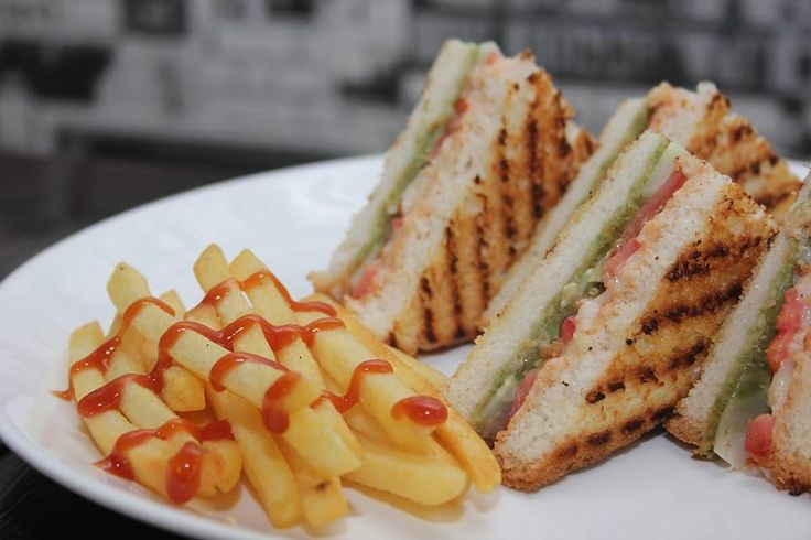 Our Bombay grilled sandwich gets the name by its peppery Indian flavour!  #cafeholic #pune #pashan #baner  #aundh #sandwich #bombay #frenchfries #foodie #foodporn #food #fun #cafe #music #fun #games