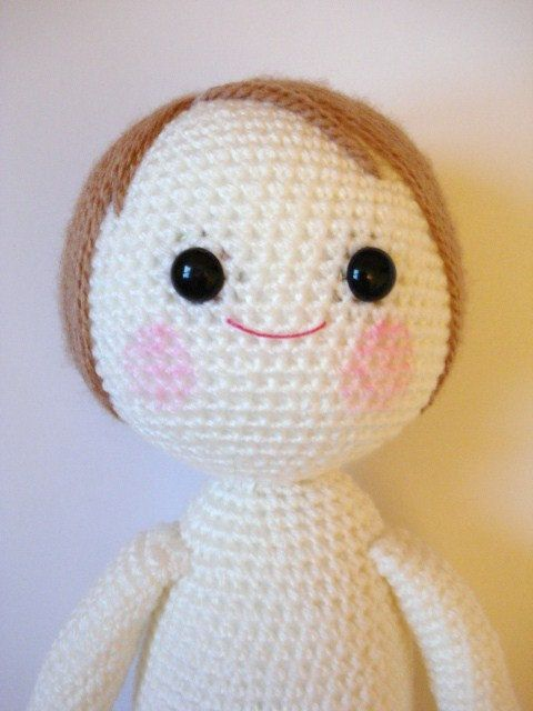 crochet dolls with yarn hair and button eyes - very similar to rabbits, just without the ears