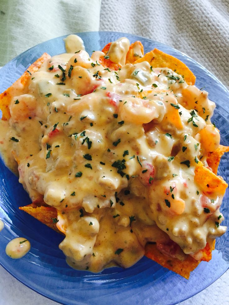 SHRIMP AND GROUND TURKEY NACHOS   1 pound shrimp with tail off  1 pound ground turkey  1 block of VELVETA cheese   1 Can of hot rotel  1 can cream of chicken   Seasonings Goya,creole season,garlic powder   Cook shrimp and turkey ground beef with the seasonings once finish drain return to heat. Place VELVETA and rotel cream of chicken in skillet or pot cook everything until melted serve with your choice of chips  enjoy #nachos #shrimp #groundturkey