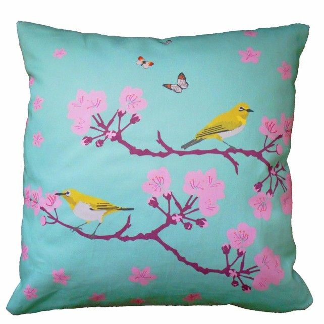 Cherry Blossom Cushion by Flamingo Tree. Modern Chinoiserie style turquoise cushion with pretty pink blossom and yellow birds. Designed and hand crafted by Karen Potter