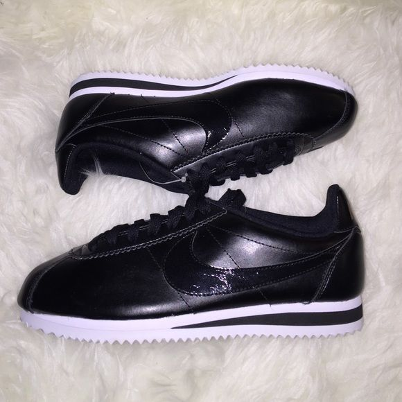 NEW NIKE CORTEZ PATENT BLACK ROSE GOLD WMNS SZ 7 NO TRADES! Brand new! Amazing sneakers! Wish these were in my size! Black leather with a patent black nike check. Classic Colorway! You can't go wrong with a black and white shoe! ROSE GOLD lettering. I only have 1 of these for sale!! Don't miss out! ALL MY ITEMS ARE 100% AUTHENTIC. CHECK OUT MY FEEDBACK. I have lots of other Nikes for sale. Please check out my closet! Nike Shoes Athletic Shoes