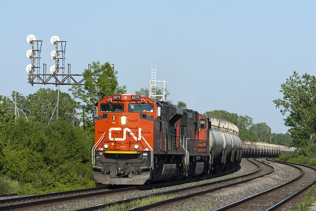 Canadian National widecabs lead a solid train of oil tankers through Dorval, Quebec.