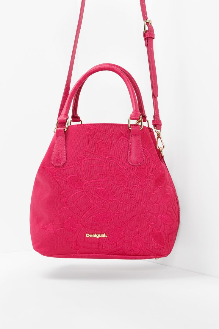"This little red handbag from Desigual's ""Learn"" collection will be your new best friend this Spring. With cute and classy gold zips and keychain details, you'll be the star of any party!"