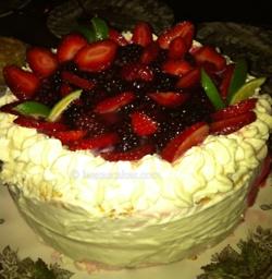 Celebration gateaux with blackberries, fresh fruit yoghurt mousse, light sponge and fresh cream.