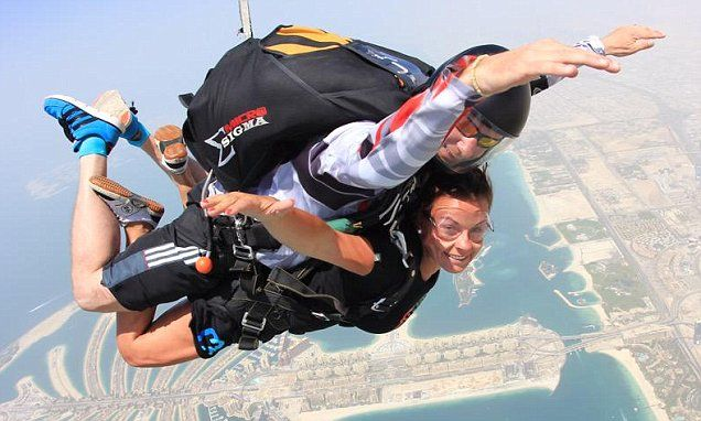 Daredevil Coleen Rooney jumps out of a plane for thrilling skydive