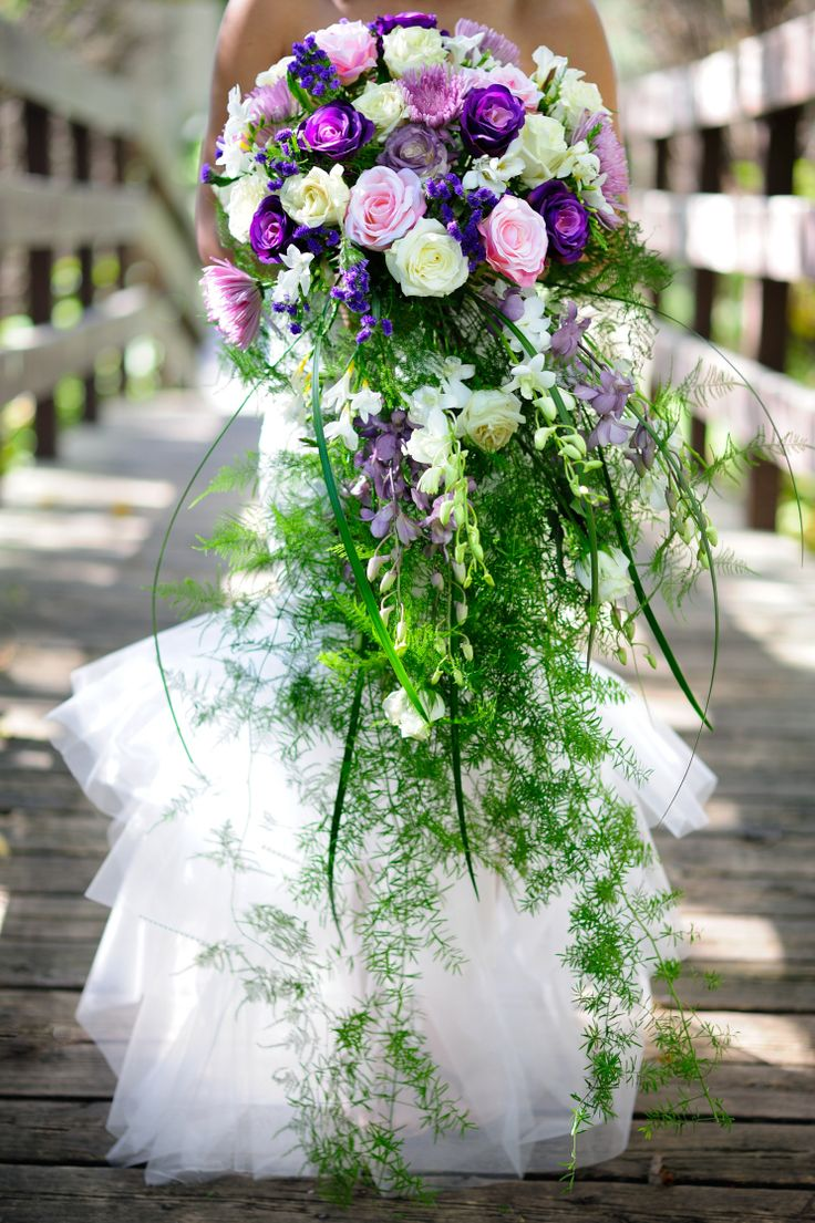 A big cascading bride bouquet in purple and lavander shades. designed by Dream Bloom and captured by Glen Cabotage photograpy