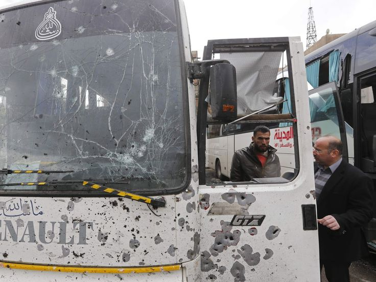 Syrians check a damaged bus - Ardan News