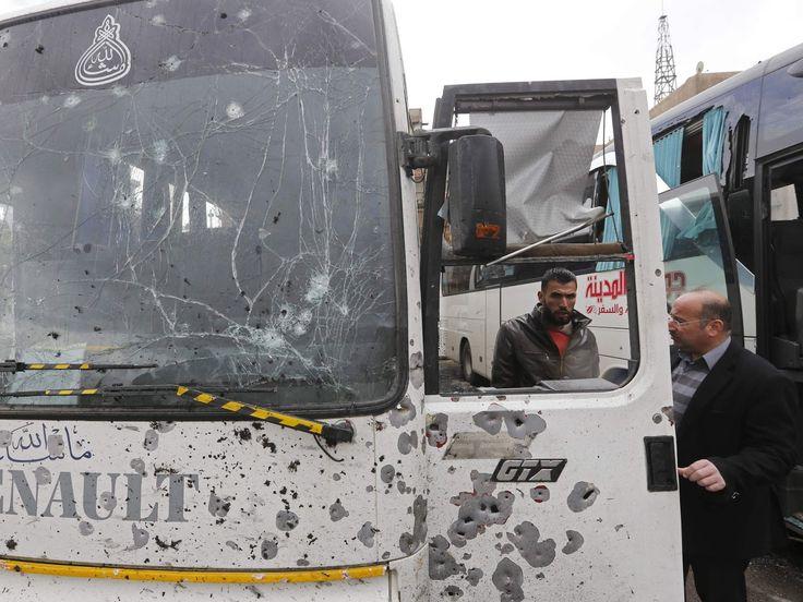 Syrians check a damaged bus - Ardan News