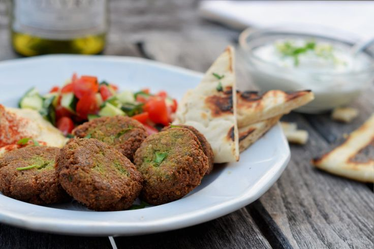 A popularvegetarian dish eaten throughout the Middle East and one of my all-time favorite street foods, falafel aredeep-fried balls or patties made from ground chickpeas or fava beans. They'retraditionally stuffed in apita orserved as part of a mezze platter (an assortment of appetizers) with hummus, tahini sauce, and yogurt sauce. Falafel isone of those dishes …