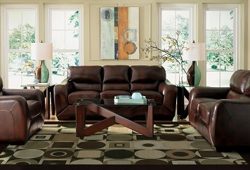warm leather (not overstuffed or bradded) couch and loveseat set  2600