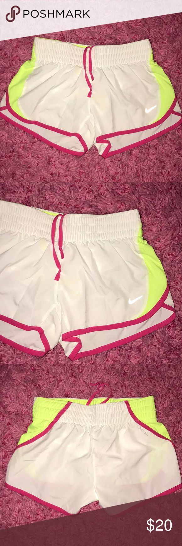 NWOT Nike Neon Shorts✔️ NWOT Nike Neon Shorts. Perfect condition. Have built in underwear type briefs as seen in picture Nike Shorts