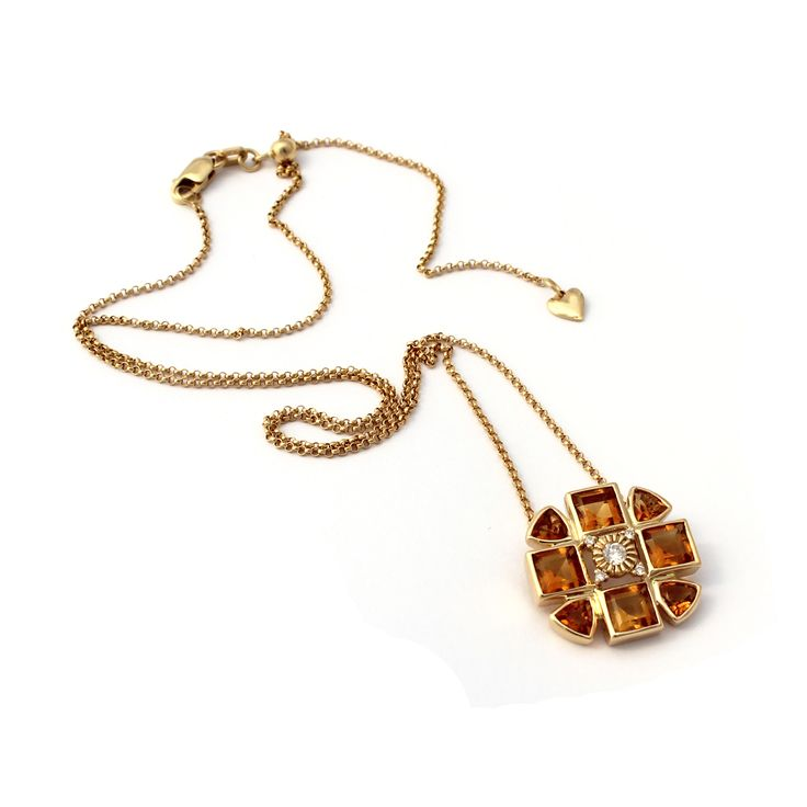 The pendant is made from 18kt yellow gold diamonds and citrine.  Citrine is a beautiful honey coloured golden gemstone that complements all skin tones. The 18kt gold compliments citrine beautifully.