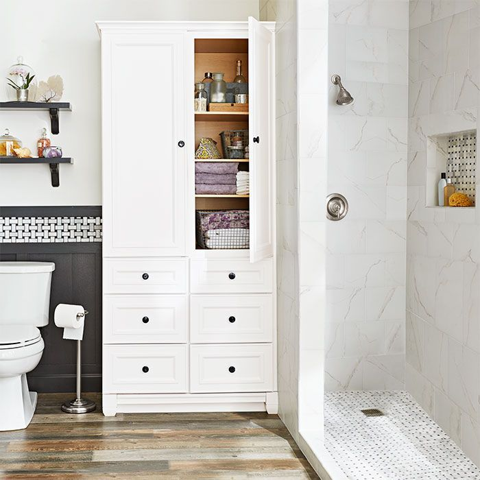 In Lieu Of A Closet A Tall Armoire Satisfies Bathroom Storage