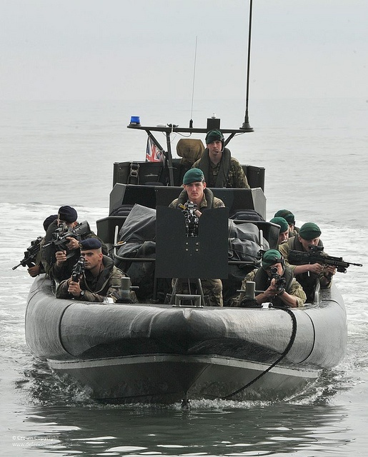 French Marines of the Second Infantry Regiment of the French Marine Corps and Royal Marines of 3 Commando Brigade are pictured in a Rigid Inflatable Boat during a joint beach assault exercise.