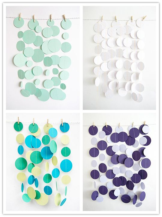 Hanging dots. If you tied these to the string instead of using clothespins, these would look awesome hanging from a cake or guestbook table.