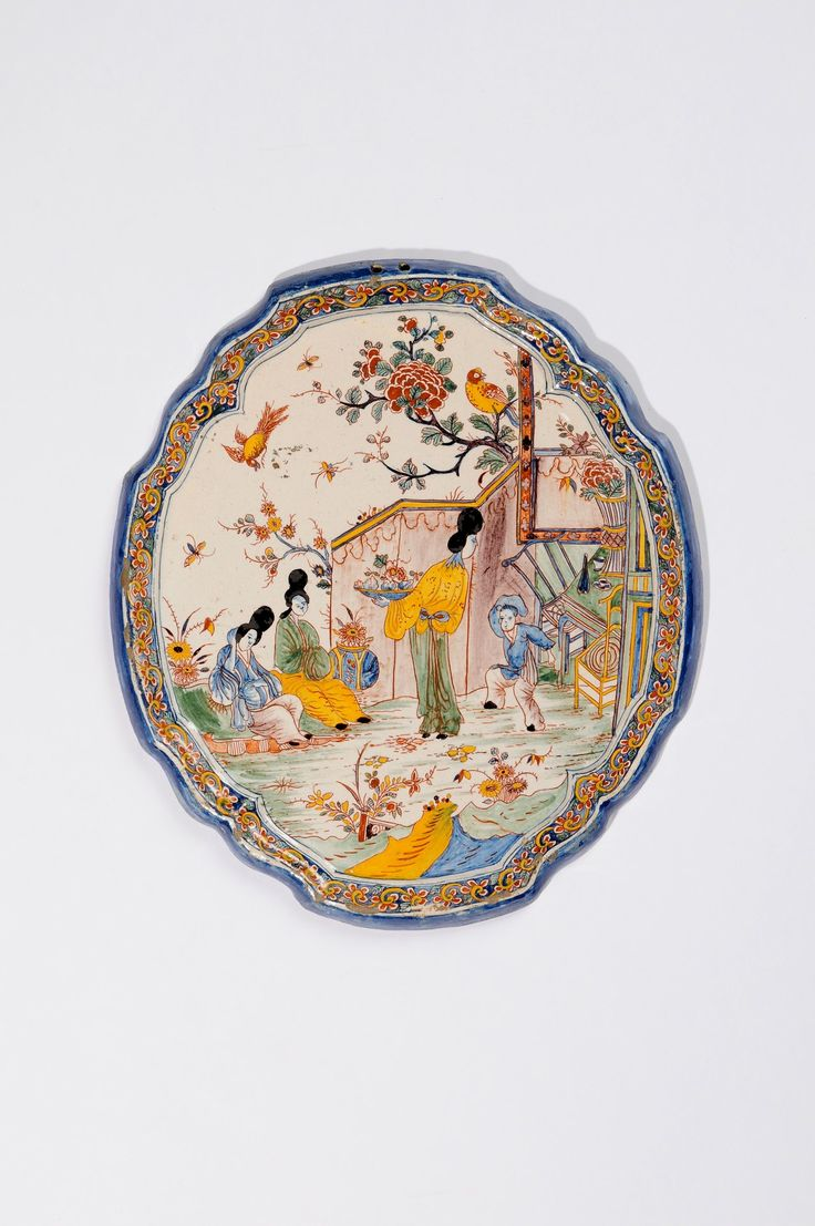 Collection item D8255. Polychrome Chinoiserie Shaped Oval Plaque Delft, circa 1740-60  35.1 x 31 cm. (13 13/16 x 12 3/16 in.)     Share      Download Download larger image     Images on this website are licensed under a Creative Commons Attribution-NoDerivs 3.0 Unported License.