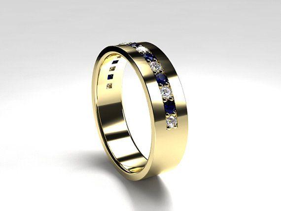 Men's yellow gold wedding band with blue sapphires and diamonds by TorkkeliJewellery, $2675.00