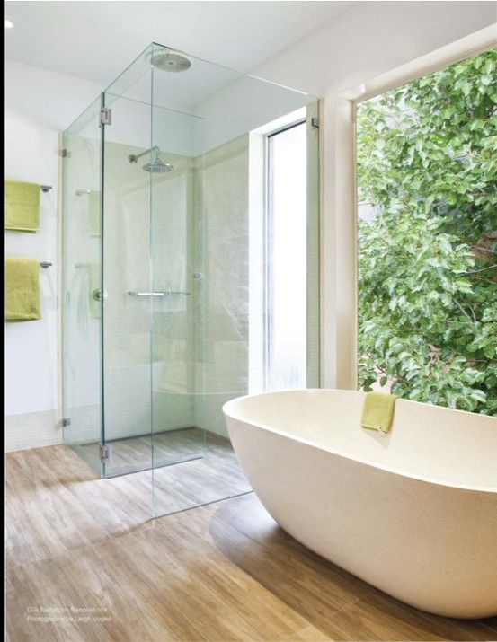 could do tiled hard woods throughout with framless shower (no step up)... minus the bathtub for guest bath