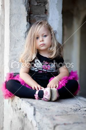 Lovely toddler blonde girl sits on ruins — Stock Image #4298755