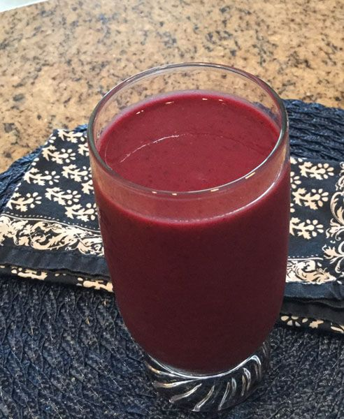 Banana, frozen fruits, beets, and kale smoothie that is yummy any time of day.