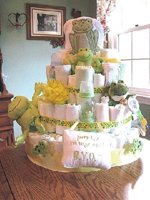 Frog Diaper Cake: She used a baby bath towel as the center, and the frog hat part of the towel is at the top!