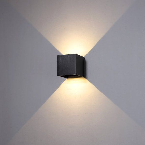 This wide beam angle black up and down outdoor wall light