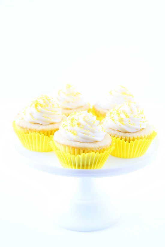 Lemon Curd Cupcakes Recipe on twopeasandtheirpod.com Lemon cupcakes filled with lemon curd and topped with buttercream frosting. Everyone LOVES these cupcakes!