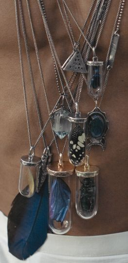 Love these necklaces with bottles.