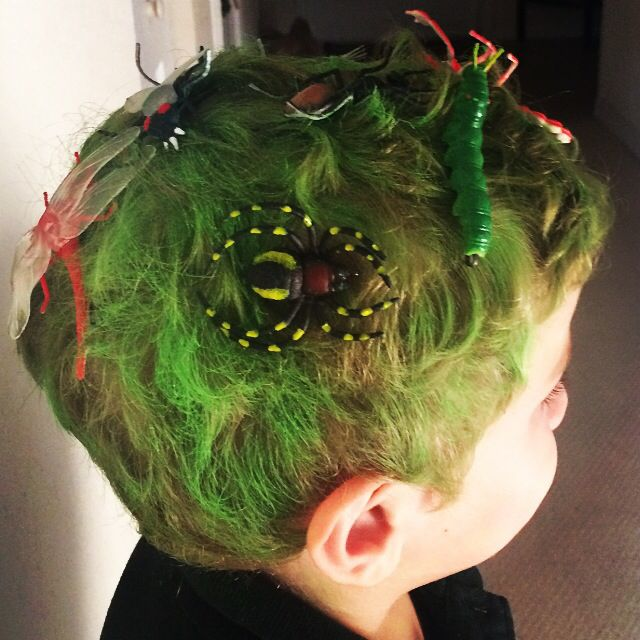 This was a hug hit at school for crazy hair day!! Green hair spray, then used a glue gun to glue plastic onto bobby pins. Simple. Easy. Fun. #crazyhairday