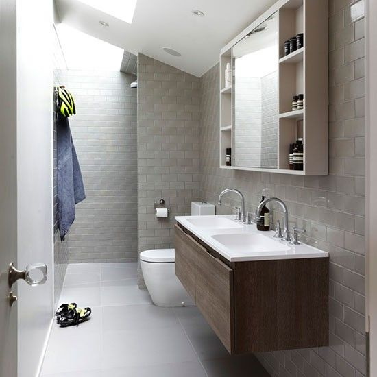 long narrow bathroom with sloping roof and skylight