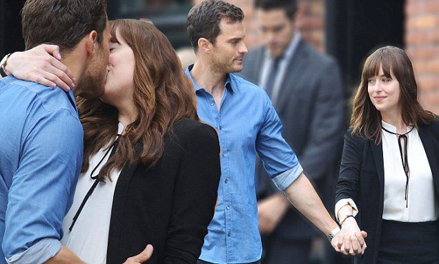 Jamie Dornan plants kiss on Dakota Johnson during Fifty Shades filming