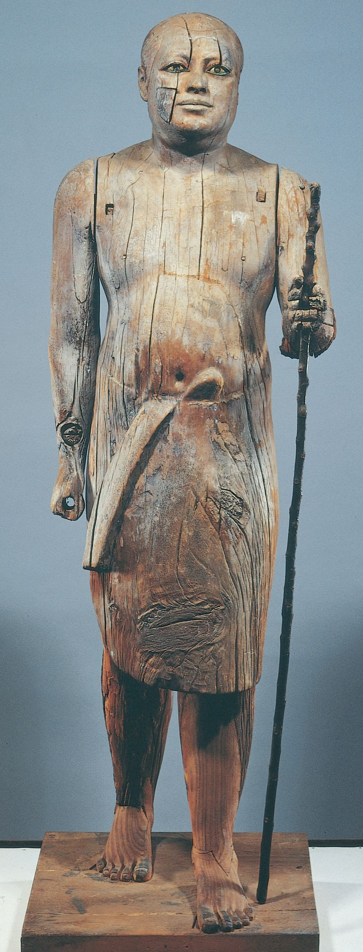 "Statue of ""Sheikh el-Balad"" Representing ""Ka-aper""- EGYPTIAN MUSEUM, CAIRO, EGYPT. ""Sheikh el-Balad"", Arabic title for the chief of the village, was the name given to this remarkable wooden statue discovered by the workmen of ""Auguste Mariette"", the French archaeologist, because it resembled their own village chief."