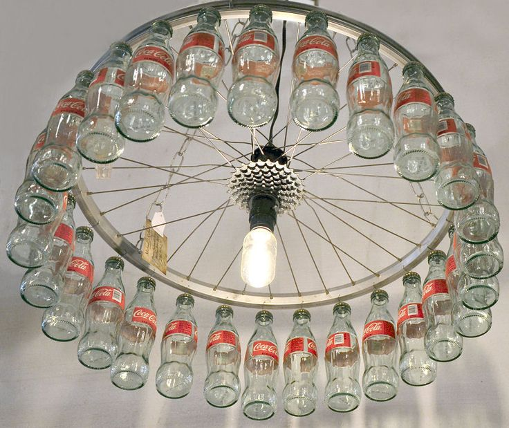 Light made from an old bike wheel and small glass coke bottles ~ Mike Richard Southern Accents Architectural Antiques