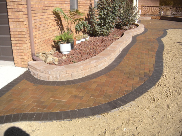 brick paver walkway with charcoal border/ stone edging
