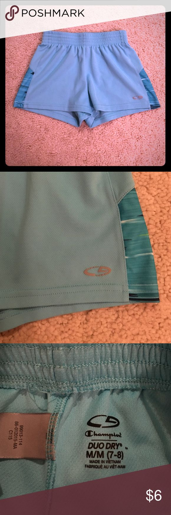 Champion brand kids athletic workout shorts M 7-8 This is a pair of turquoise blue colored duo-dry elastic/drawstring waist shorts by the Champion brand kids children's clothing line in girls size medium, meant to fit a size 7-8. These shorts are in excellent used condition! Thanks for looking!!! Champion Bottoms Shorts