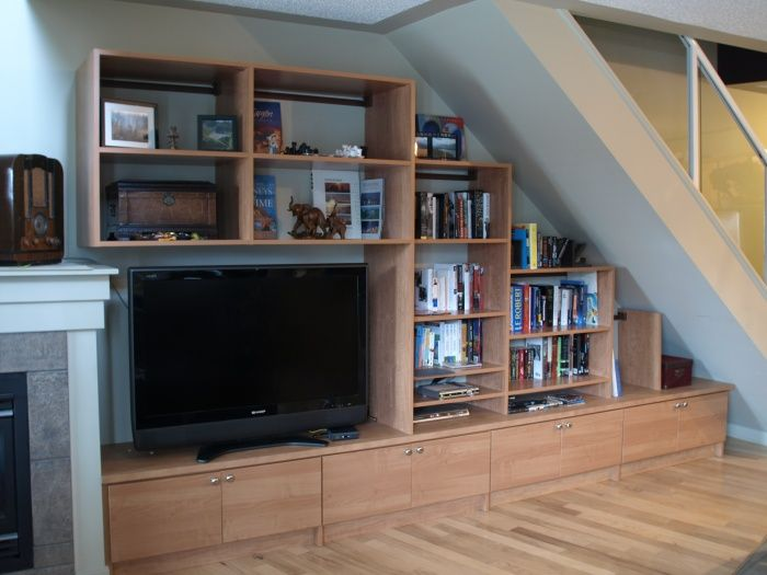 Under stairs entertainment center candlelight media unit for Tv showcase designs under staircase