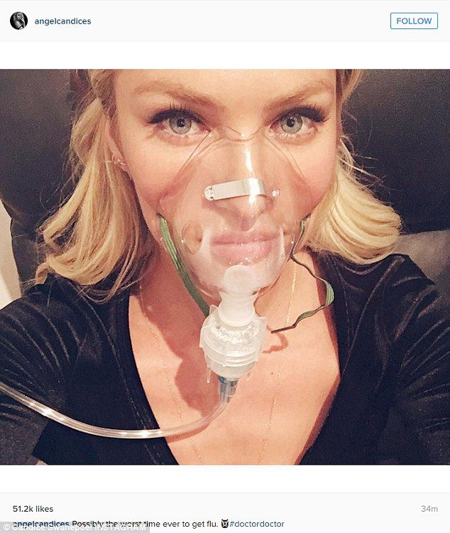 Oh no! Candice Swanepoel shared this selfie of herself with an oxygen mask early Thursday with the caption: 'Possibly the worst time ever to get flu. #doctordoctor'