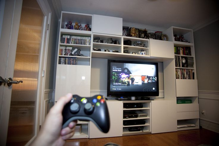 video game room wall tv and console shelves ikea besta entertainment center via. Black Bedroom Furniture Sets. Home Design Ideas