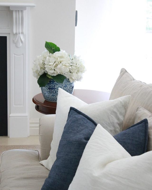 Blue and White living room. White hydrangeas in a vase.