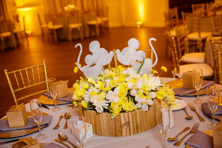 Our Disney wedding reception centerpieces at the beautiful Highland Manor in Apopka, FL. Photo credit to Steven Miller Photography and decor assistance by Exquisite Events.   Mickey & Minnie Mouse