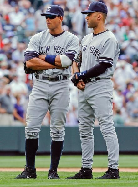 New York Yankees third baseman Alex Rodriguez, left, looks on with shortstop Derek Jeter as starting pitcher Roger Clemens heads off the field after being pulled in the fifth inning of the Colorado Rockies' 4-3 victory in an interleague baseball game in Denver on June 21, 2007. (David Zalubowski/AP)