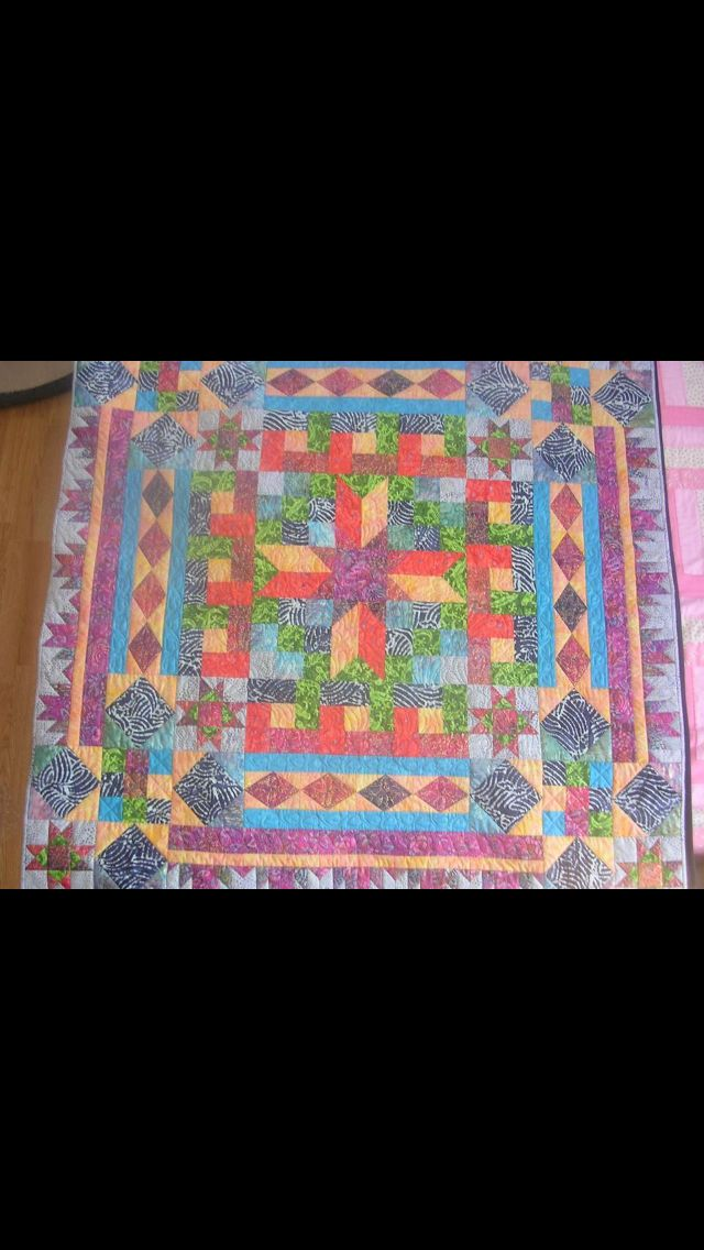 My AQS Block Buffet Mystery Quilt, I want to do this one.  Love the block variation In this quilt!