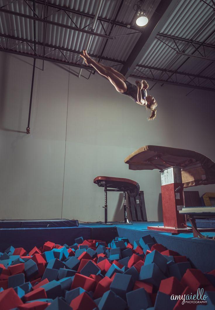 infinity gymnastics chicago il gymnastics photo shoot dramatic lighting bars beam vault