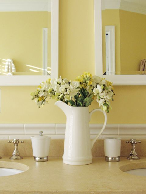 Soft yellows with white pretty bathroom colors the for Bathroom accessories yellow