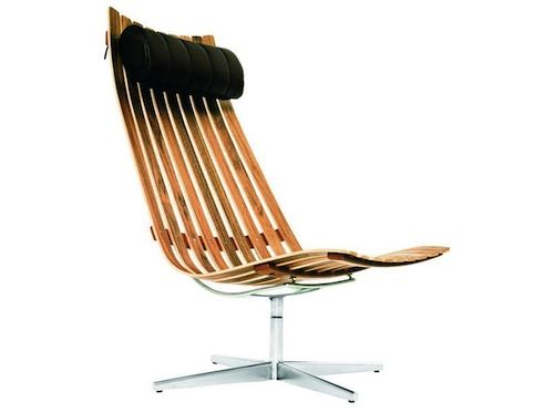 Scandia Senior Easy Chair  This is another designed by Hans Brattrud and built by Fjord Fiesta. The wood is American walnut and the bolster cushion is black leather.    Read more at Design Milk: http://design-milk.com/new-products-at-merchant4/#ixzz2JoTlLIzp