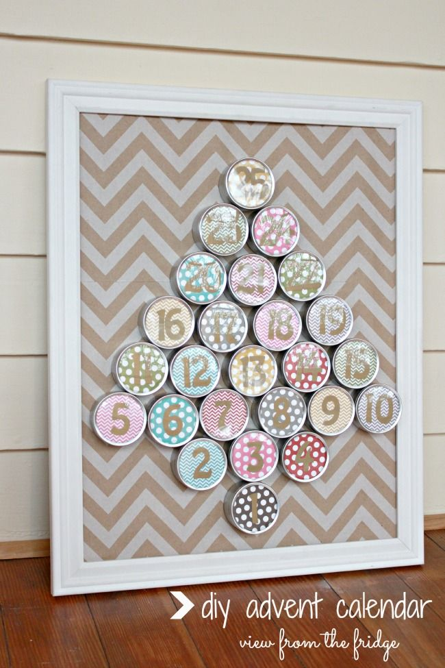 DIY Advent Calendar - Made from Favor Tins and Pretty Scrapbook Paper!  So easy ... and it actually holds some goodies for each day!  LOVE IT!