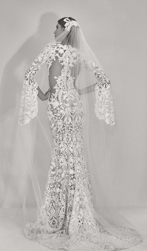 Fabulously chic long bell sleeve lace cut-out fit-and-flare style wedding dress; Featured Dress: Elie Saab